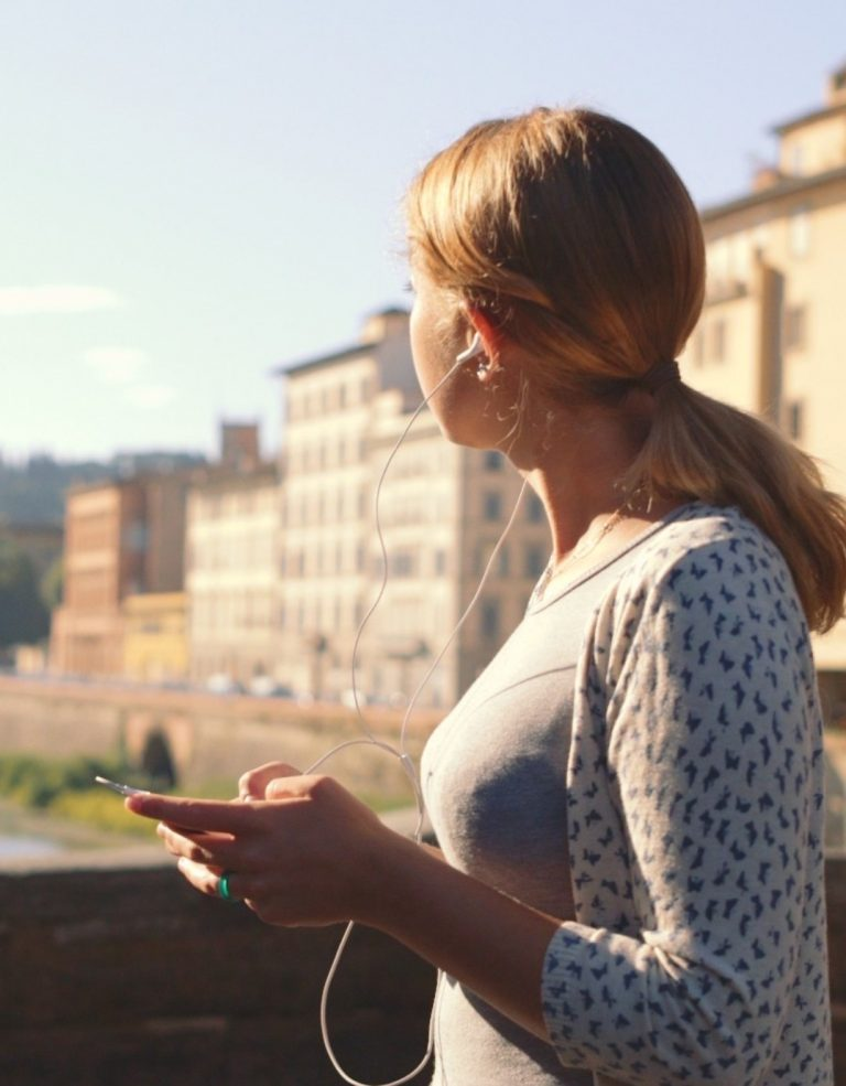 Female holding a smart phone in Florence