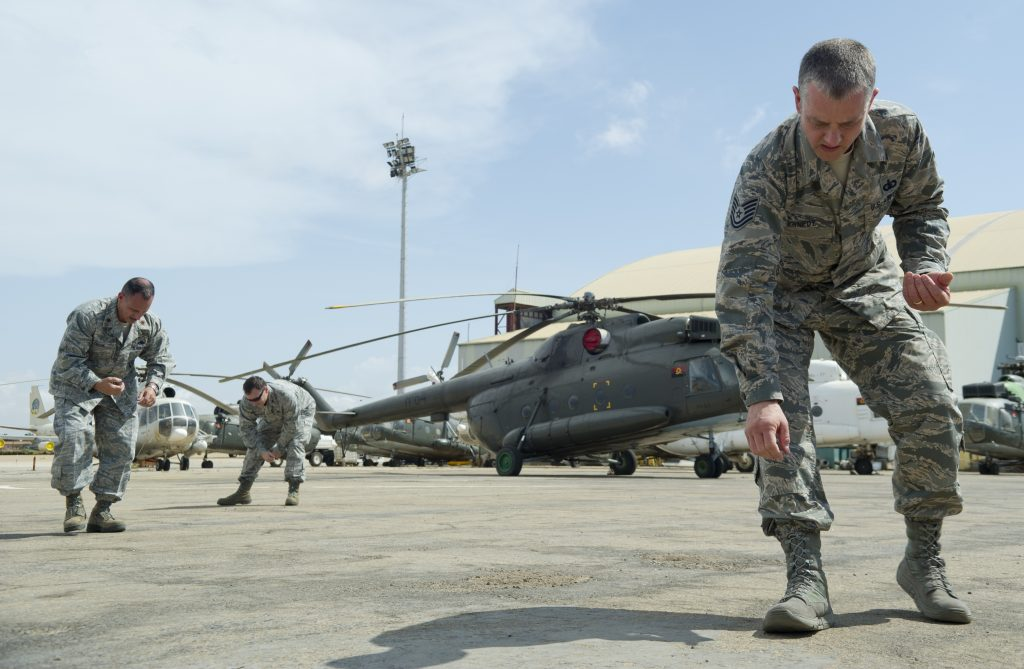 U.S Airforce men manually track and collect FOD on an airbase. The FOD app speeds up this process