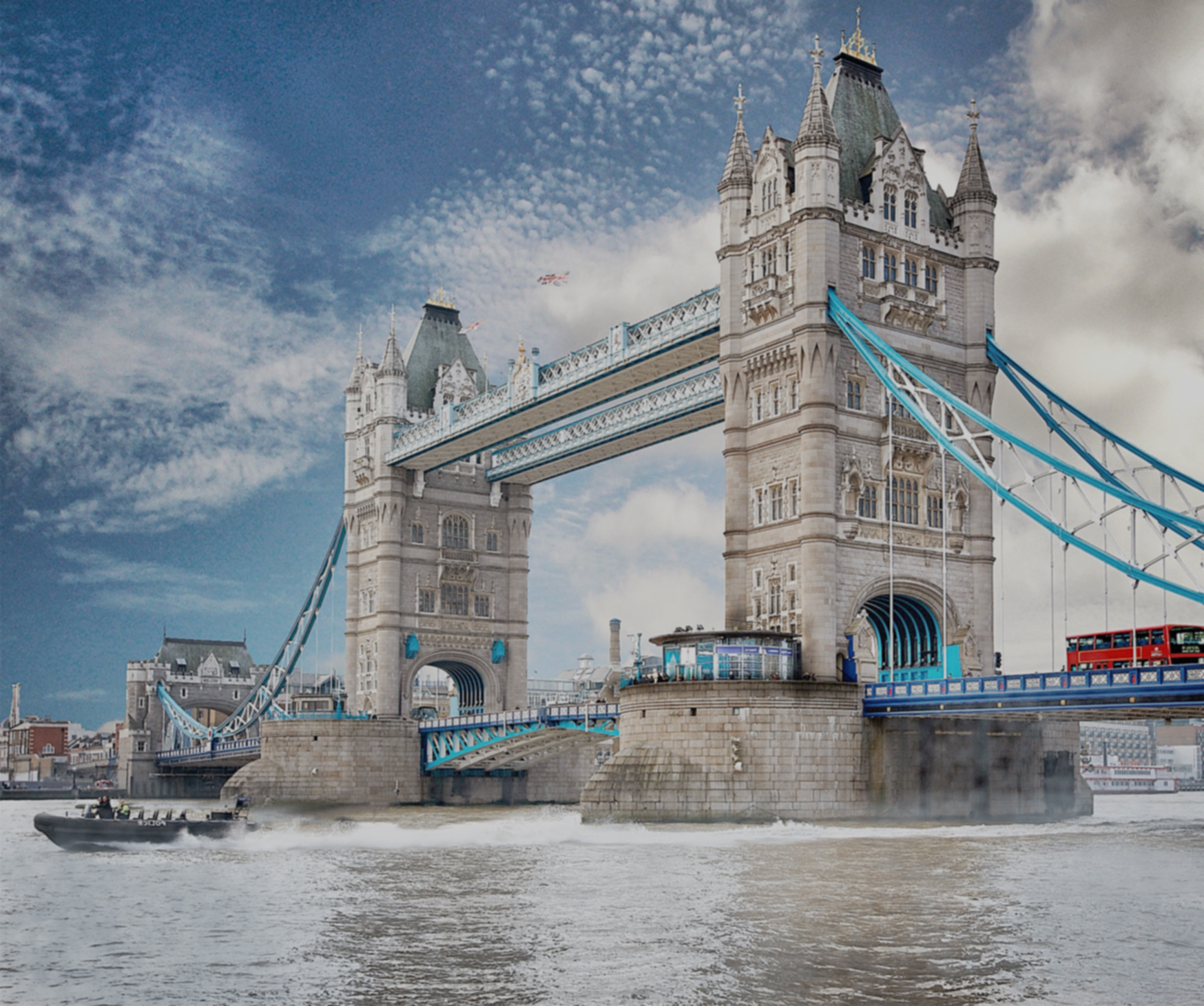 Image shows London Bridge in all its glory against a sunny but cloudy sky