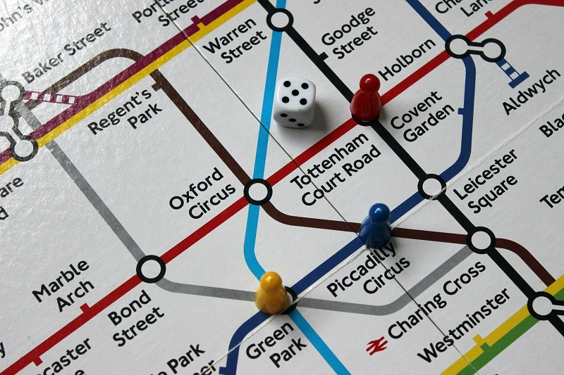 London tube map as a board game, with play pieces and a dice