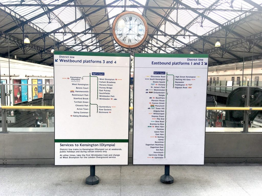 London train line platform signs, showing station stops from the eastbound and westbound platforms.