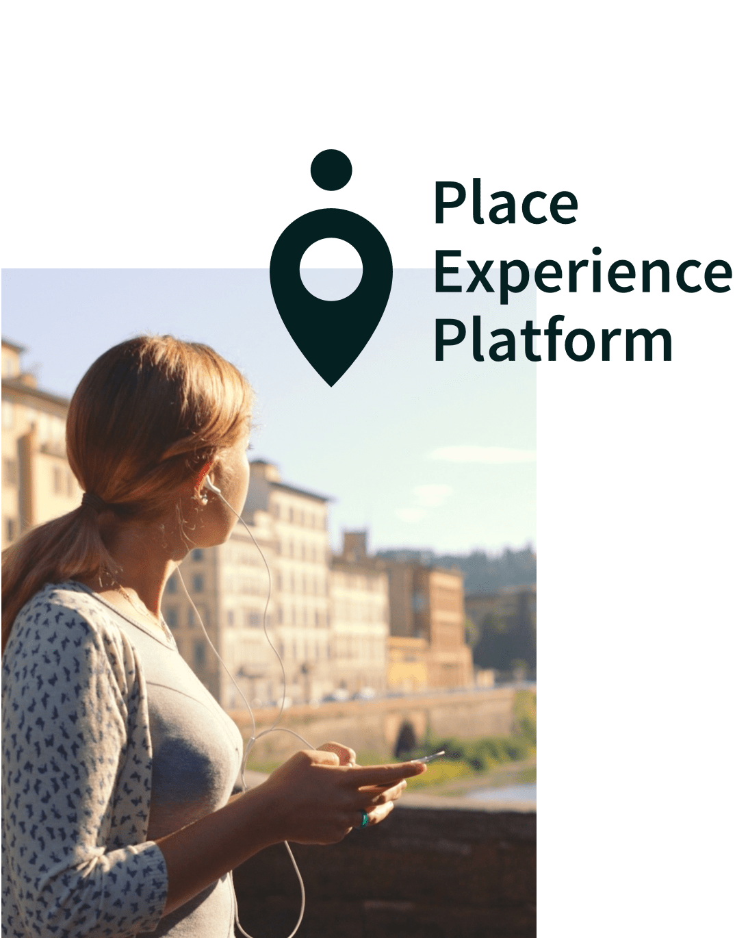 Place Experience Platform logo, overlaid on a photo of a woman wearing headphones, holding a phone, looking out over at a city sunset.