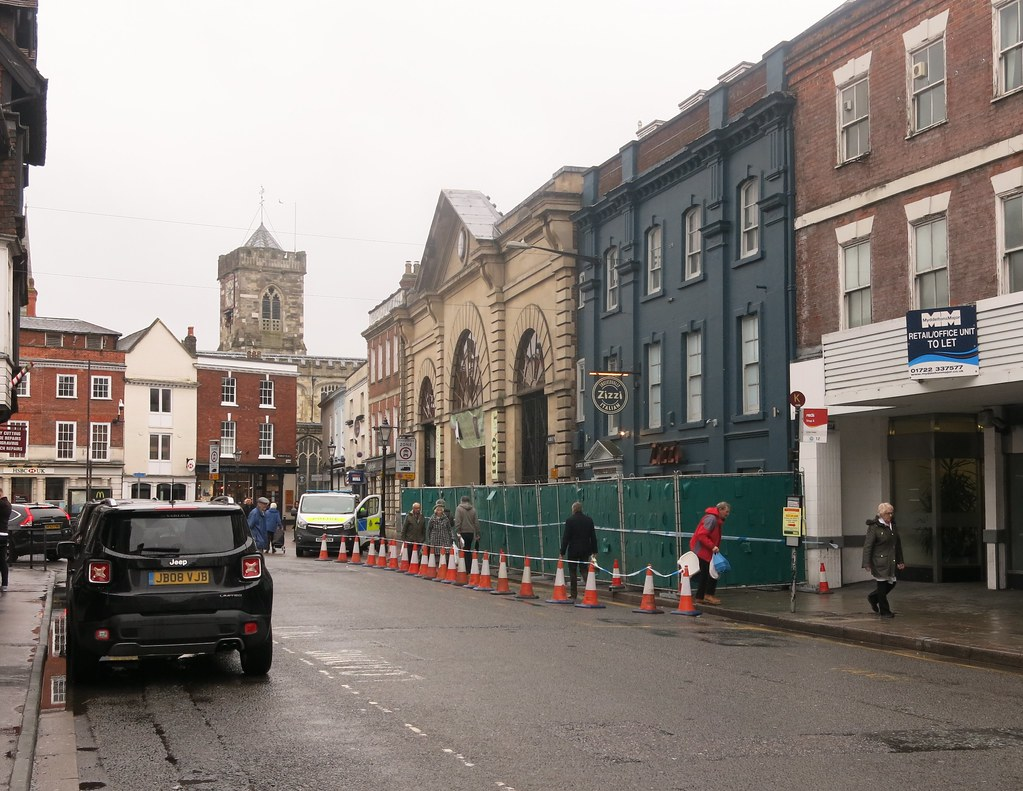 Image of Salisbury High Street after the Novichok instance - with much of the road and venues closed off with police vehicles and orange road cones