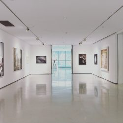 The new digital experience - image shows an art exhibition in a white room with no people