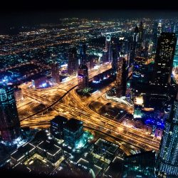 timelapse cityscape photography during night time, shot from birds eye view - with lights representing the connectivity of a smart city